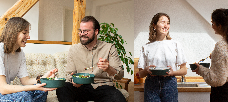 Glückliche Menschen essen aus einer Mehrweg to go Verpackung